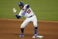 Los Angeles Dodgers' Mookie Betts celebrates a double against the Tampa Bay Rays during the sixth inning in Game 6 of the baseball World Series Tuesday, Oct. 27, 2020, in Arlington, Texas. (AP Photo/Eric Gay)