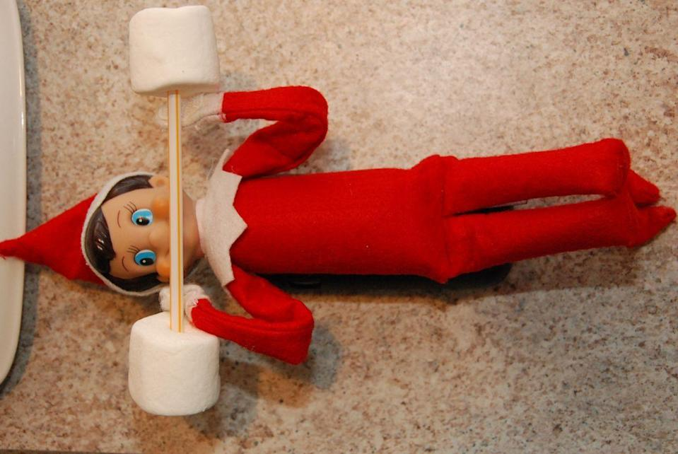 """<p>Make marshmallow dumbbells to help Mr. Elf bulk up for the holidays.</p><p><strong>Get the tutorial at <a href=""""http://dirtydiaperlaundry.com/elf-on-the-shelf-ideas-week-2/"""" rel=""""nofollow noopener"""" target=""""_blank"""" data-ylk=""""slk:Dirty Diaper Laundry"""" class=""""link rapid-noclick-resp"""">Dirty Diaper Laundry</a>.</strong></p><p><a class=""""link rapid-noclick-resp"""" href=""""https://www.amazon.com/Flexible-Plastic-Straws-200-Pack/dp/B077MQJ3PD?tag=syn-yahoo-20&ascsubtag=%5Bartid%7C10050.g.22690552%5Bsrc%7Cyahoo-us"""" rel=""""nofollow noopener"""" target=""""_blank"""" data-ylk=""""slk:SHOP STRAWS"""">SHOP STRAWS</a></p>"""