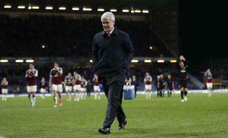 Stoke City manager Mark Hughes looks dejected after the match