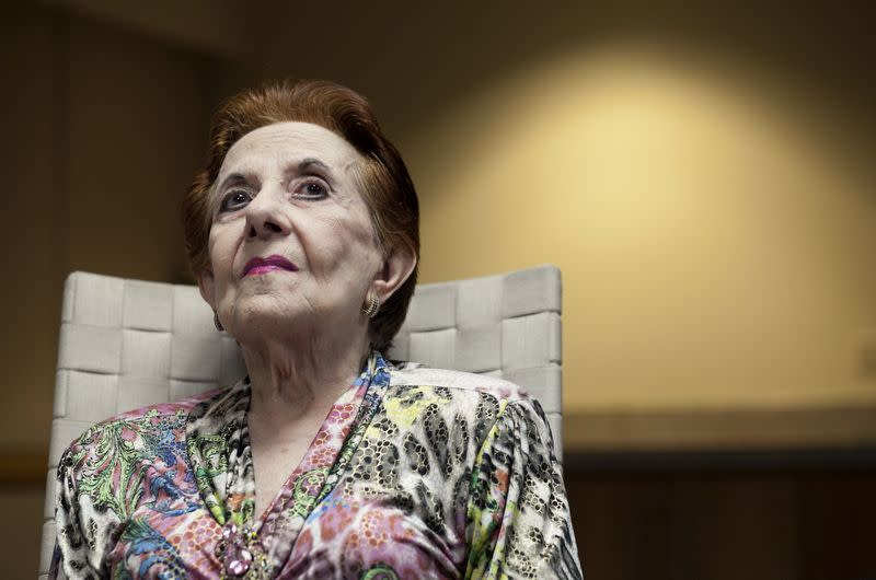 Mabel Ladicani, an 88-year-old widow living in San Juan and long time client of the UBS, looks up during an interview with Reuters in San Juan
