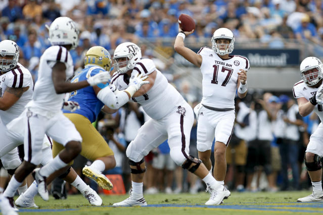 "Texas A&M quarterback <a class=""link rapid-noclick-resp"" href=""/ncaaf/players/267226/"" data-ylk=""slk:Nick Starkel"">Nick Starkel</a> throws against UCLA during an NCAA college football game, Sunday, Sept. 3, 2017, in Pasadena, Calif. UCLA won 45-44. (AP Photo/Danny Moloshok)"
