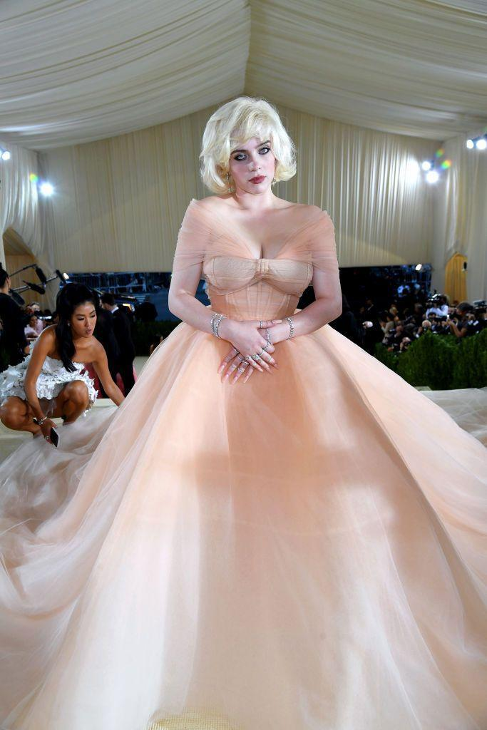"""<p>The """"Lost Cause"""" singer and Met Gala co-chair served up pure retro beauty queen realness. Everyone saw Marilyn Monroe, but to us, she looked like Miss Peaches and Cream 1954. Just a gorgeously grown up fantasy look—which she told interviewers was inspired by Holiday Barbie—perfectly executed. </p>"""