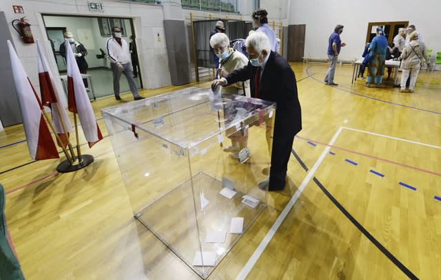 Strict hygiene measures were in place at polling stations (Czarek Sokolowski/AP)