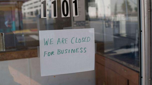 PHOTO: In this May 7, 2020, file photo, a sign at a motel lobby states 'WE ARE CLOSED FOR BUSINESS' during the coronavirus pandemic in Atlantic City, N.J. (Mark Makela/Getty Images, FILE)