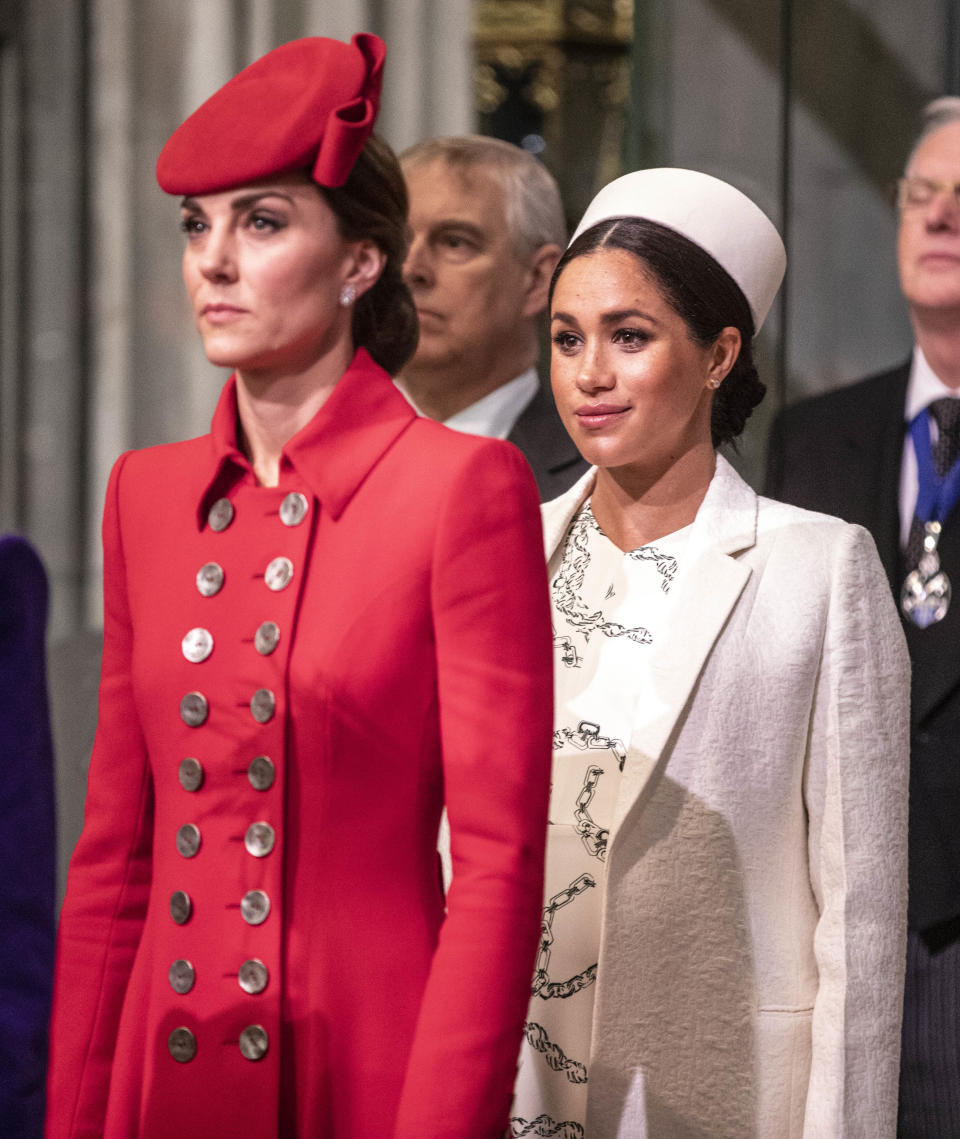 The Duchess of Cambridge stands with the  Duchess of Sussex at Westminster Abbey for a Commonwealth day service.