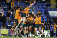 Australian players celebrate their win over South Africa in their Rugby Championship match on Sunday, Sept. 12, 2021, Gold Coast, Australia. (AP Photo/Tertius Pickard)
