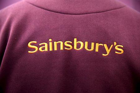 The Sainsbury's Logo is displayed on an employee uniform in a store in London, Britain