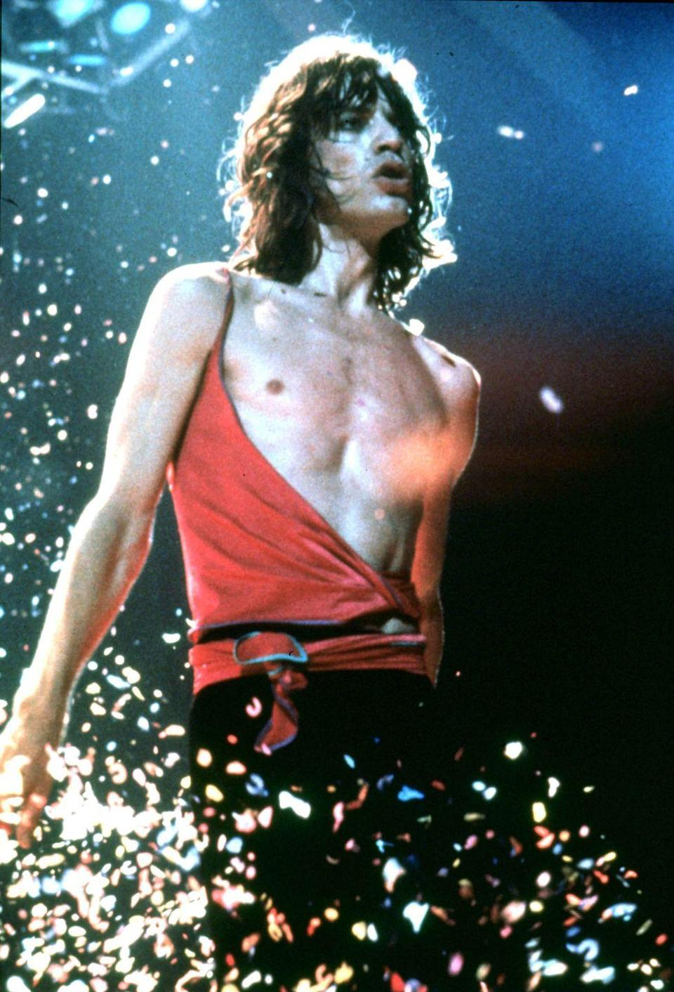 <p>Mick Jagger of the Rolling Stones performing on stage during their European tour in 1976</p>