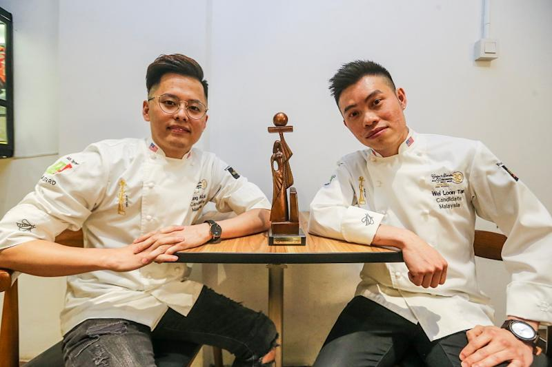 Loi Ming Ai (left) and Tan Wei Loon with the World Pastry Cup trophy. — Picture by Hari Anggara