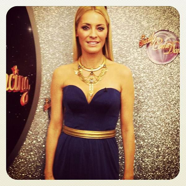 <b>Tess Daly, Strictly Come Dancing, Sat 1st Dec </b><br><br>The presenter looked immaculate on Strictly in the Navy Admiral dress by Beulah London, cinched in at the waist with a gold belt by Carlos Miele USA and a pair of Kurt Geiger heels.<br><br>© Twitter / TessDalyUK