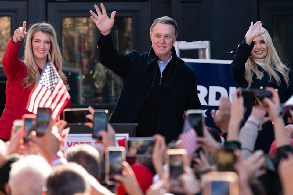 Ivanka Trump and Senators Kelly Loeffler and David Perdue wave to the crowd atr a campaign event on December 21, 2020 in Milton, Georgia. (Elijah Nouvelage/Getty Images)