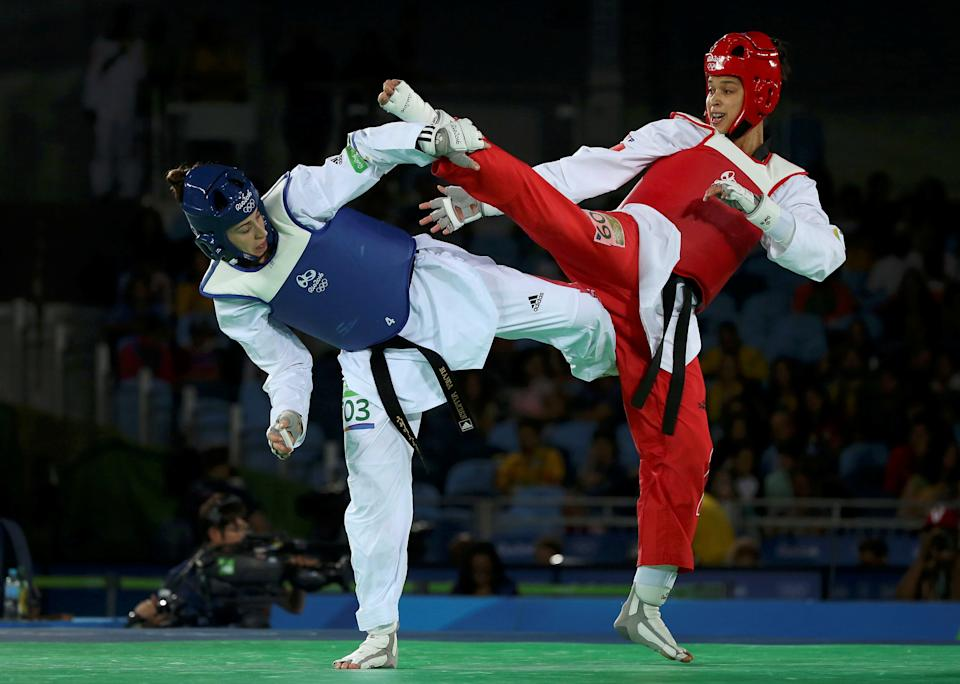 Walkden fell in love with taekwondo after a school friend suggested she tag along (Picture: Reuters)