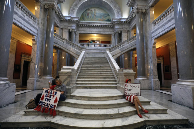 "<p>Kentucky Public school teachers sit outside the House chamber as they rally for a ""day of action"" at the Kentucky State Capitol to try to pressure legislators to override Kentucky Governor Matt Bevin's recent veto of the state's tax and budget bills April 13, 2018 in Frankfort, Ky. (Photo: Bill Pugliano/Getty Images) </p>"