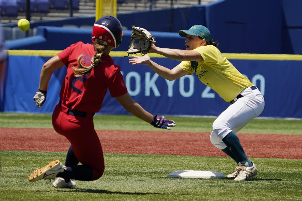 Australia's Clare Warwick, right, gets the throw in time to tag out United States' Ali Aguilar, left, at second base in the sixth inning of a softball game at the 2020 Summer Olympics, Sunday, July 25, 2021, in Yokohama, Japan. (AP Photo/Sue Ogrocki)