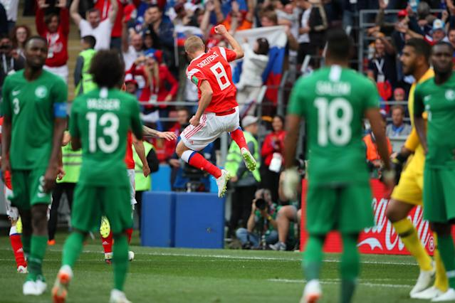 <p>Goal scorer Lury Gazinski of Russia celebrates the host nation's opener in Moscow. (Getty) </p>