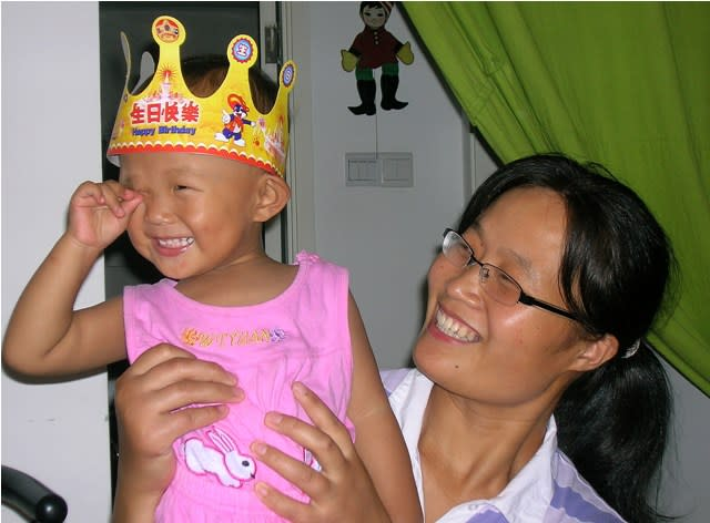 This undated photo provided by the China Aid Association shows Yuan Weijing holding her daughter, Kesi. Yuan's husband, blind Chinese legal activist Chen Guangchen, who angered authorities in rural China by exposing forced abortions, made a surprise escape from house arrest on April 22, 2012, into what activists say is the protection of U.S. diplomats in Beijing, posing a delicate diplomatic crisis for both governments. (AP Photo/www.ChinaAid.org)