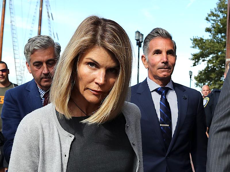 Lori Loughlin and her husband Mossimo Giannulli, right, are hoping to get their bail reduced from $1 million to $100,000. Here they are in Boston federal court in August 2019.