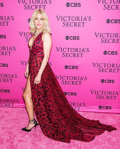 <p>Ellie Goulding got wild in a red animal print gown with a long train and thigh-high slit. </p>