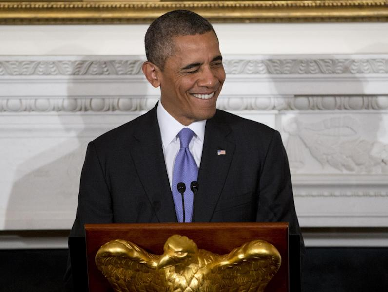 President Barack Obama winks as he speaks at an Iftar dinner celebrating Ramadan in the State Dining Room of the White House, Thursday, July 25, 2013, in Washington. (AP Photo/Carolyn Kaster)