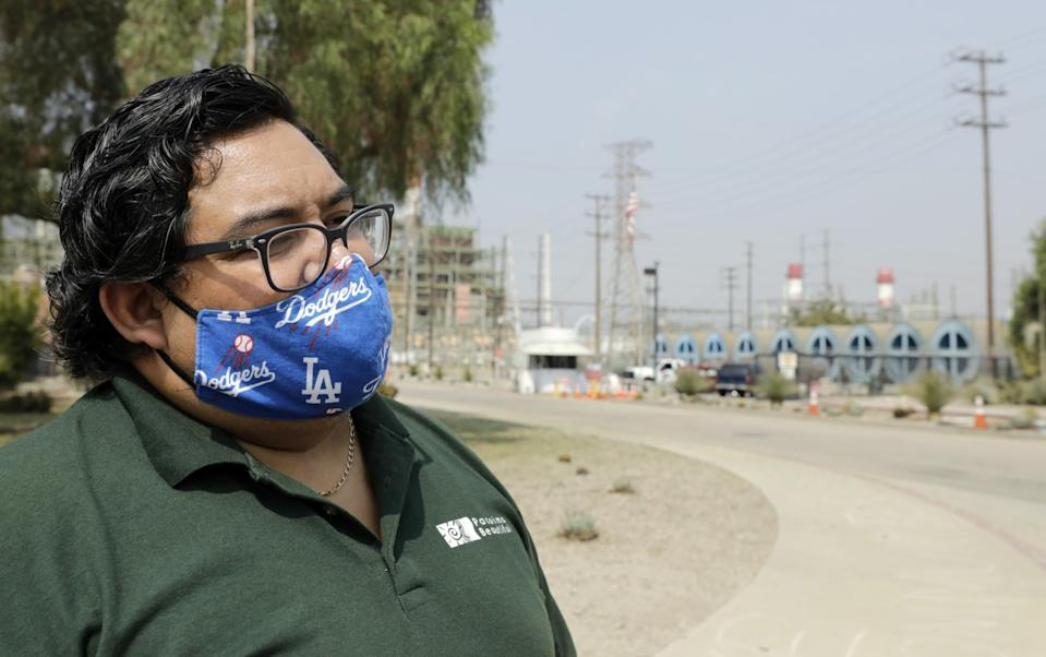 Andres Ramirez, policy director of Pacoima Beautiful, stands outside Valley Generating Station on Sept. 17, 2020.