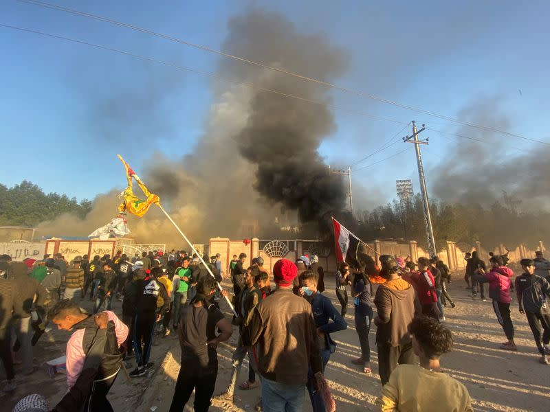 A headquarters building of Popular Mobilization Forces (Hashd al-Shaabi) burns after being torched by demonstrators during ongoing anti-government protests, in Nassiriya