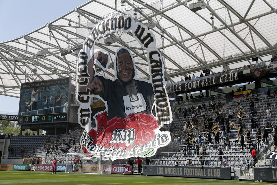 """A giant banner with the picture of Mauricio """"Mo"""" Fascio at Banc of California Stadium."""