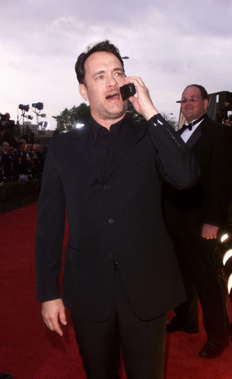 <p>Apparently Tom Hanks is on a fan's cell right now, speaking to their relative, because he's perfect.</p>