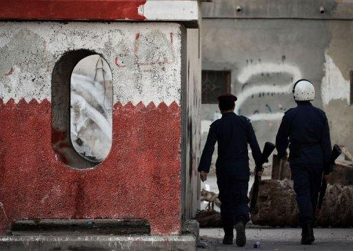 Bahraini security forces keep watch in the village of Malikiyah, south of of Manama, on January 7, 2013