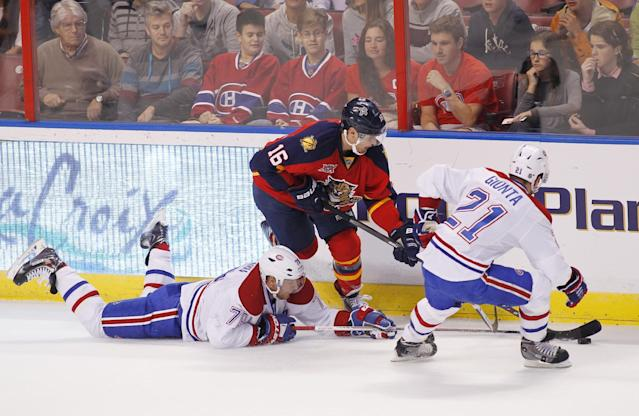 Florida Panthers center Aleksander Barkov (16) battles against Montreal Canadiens defenseman Andrei Markov (79) and right wing Brian Gionta (21) during the first period of an NHL hockey game in Sunrise Fla., Sunday, Dec. 29, 2013. (AP Photo/Terry Renna)