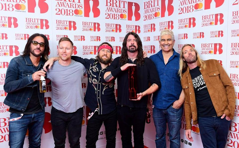 Foo Fighters with their award for Best International Group in the press room during the Brit Awards at the O2 Arena, London (Ian West/PA) (PA Archive)
