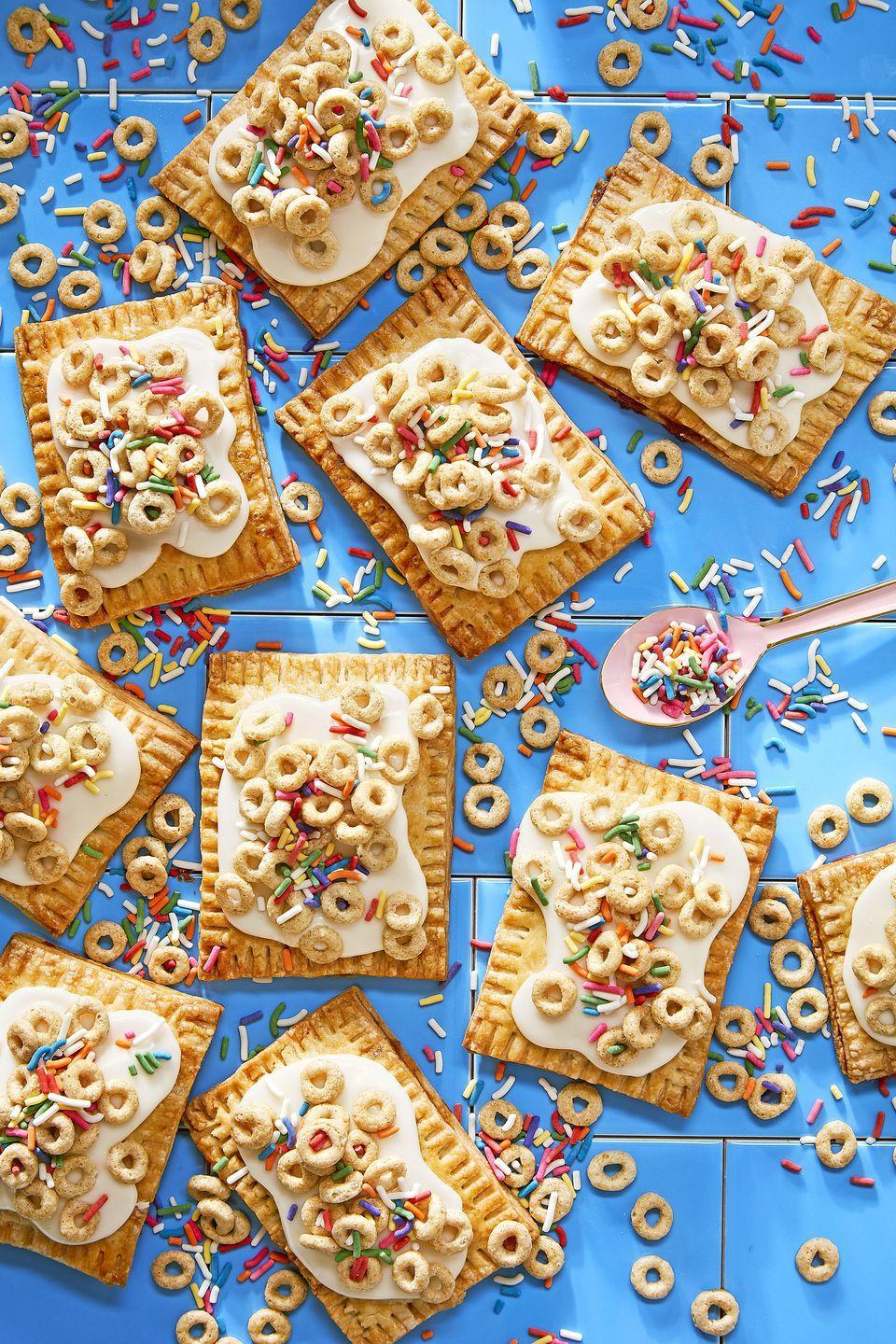 "<p>Turn your kid's favorite cereal into a party-ready turnover treat.</p><p><a href=""https://www.countryliving.com/food-drinks/recipes/a46339/honey-nut-cheerio-turnovers-recipe/"" rel=""nofollow noopener"" target=""_blank"" data-ylk=""slk:Get the Honey Nut Cheerio Turnovers recipe."" class=""link rapid-noclick-resp""><em>Get the Honey Nut Cheerio Turnovers recipe.</em></a></p>"