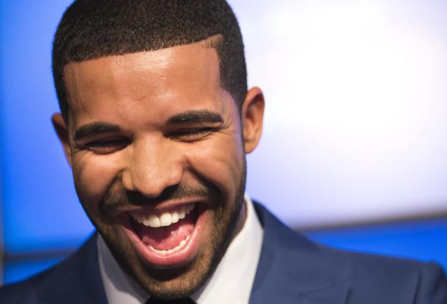 Rapper Drake smiles during an announcement that the Toronto Raptors will host the NBA All-Star game in Toronto, September 30, 2013. Toronto was selected as the host of the National Basketball Association's (NBA) 2016 All-Star Game, marking the first time the showcase event will be held outside of the United States, the league said on Monday. REUTERS/Mark Blinch (CANADA - Tags: SPORT BASKETBALL ENTERTAINMENT)