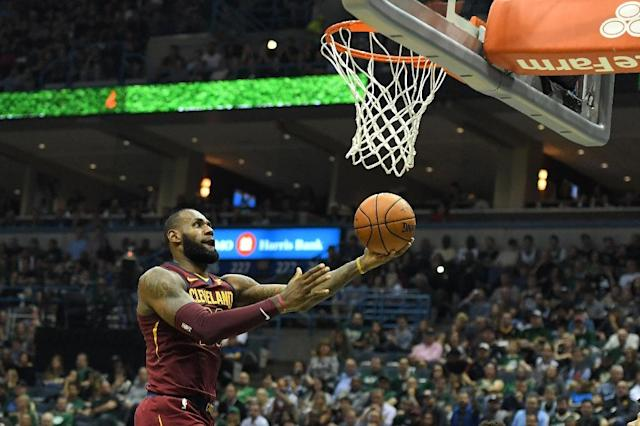 LeBron James scored 34 points and passed out 13 assists to spark a revamped Cleveland Cavaliers lineup to a 119-112 victory over the Chicago Bulls, at Quicken Loans Arena in Cleveland, Ohio, on October 24, 2017 (AFP Photo/Stacy Revere)