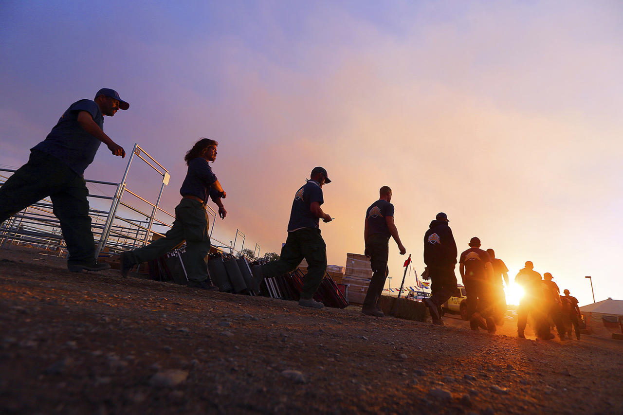 <p>Fire crews return from fighting a wildfire near the ski town of Brian Head, June 27, 2017, in Panguitch, Utah. (Scott G Winterton/The Deseret News via AP) </p>