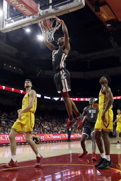 Washington State's Marvin Cannon dunks during the second half of the team's NCAA college basketball game against Southern California on Saturday, Feb. 15, 2020, in Los Angeles. (AP Photo/Marcio Jose Sanchez)