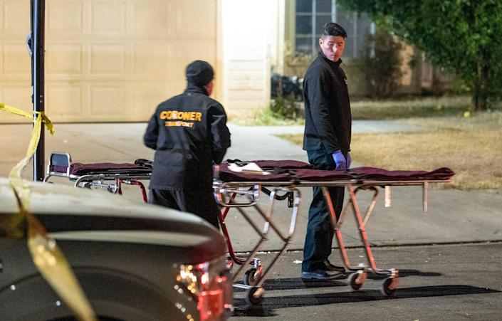 Coroners prepare to remove the bodies of shooting victims as Fresno Police investigate a shooting on Nov. 18, 2019.