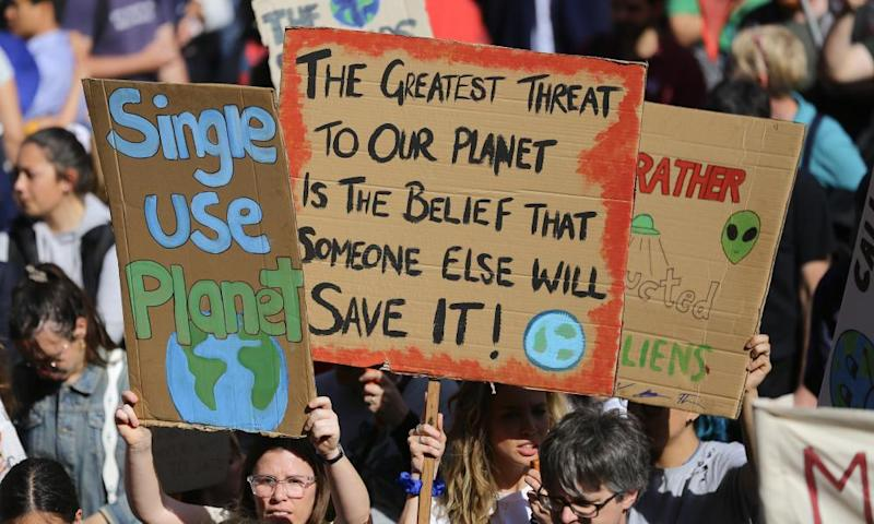 Protesters with placards as Sydney climate strike