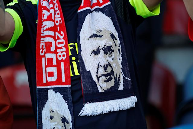 "Soccer Football - Premier League - Huddersfield Town vs Arsenal - John Smith's Stadium, Huddersfield, Britain - May 13, 2018 Arsenal fan wearing a scarf in reference to manager Arsene Wenger Action Images via Reuters/Andrew Boyers EDITORIAL USE ONLY. No use with unauthorized audio, video, data, fixture lists, club/league logos or ""live"" services. Online in-match use limited to 75 images, no video emulation. No use in betting, games or single club/league/player publications. Please contact your account representative for further details."