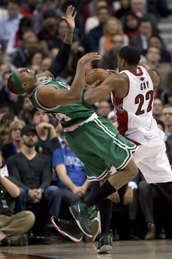 Toronto Raptors forward Rudy Gay (22) picks up an offensive foul as he drives into Boston Celtics forward Paul Pierce during second-half NBA basketball game action in Toronto, Wednesday, Feb. 6, 2013. (AP Photo/The Canadian Press, Frank Gunn)