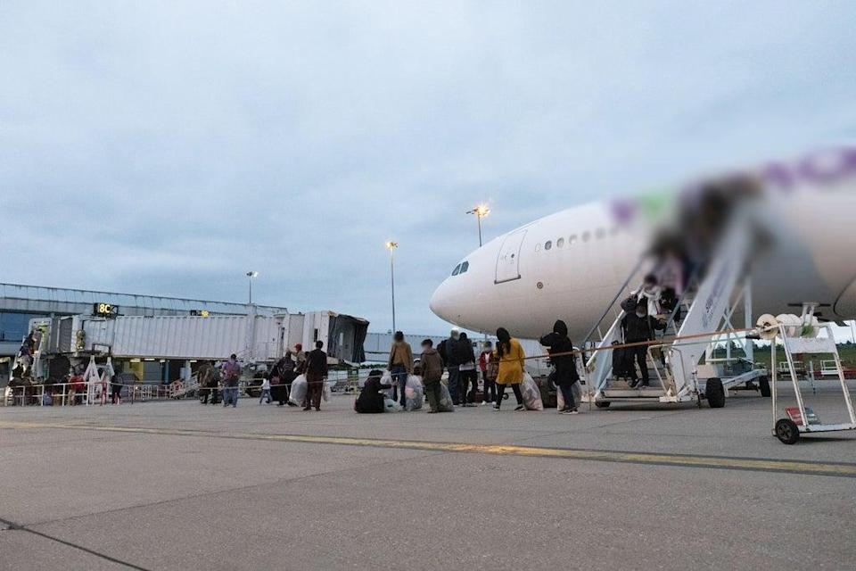 A civilian charter flight arriving from Kabul. The picture was blurred by Ministry of Defence (PA Media)