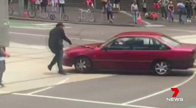 A teenage boy tried desperately to bring the Holden Commodore to a halt. Source: 7 News