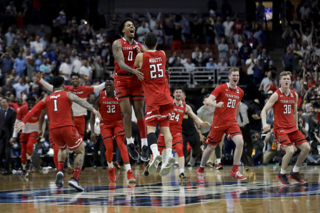 Texas Tech celebrates after a win against Gonzaga in the West Regional final in the NCAA men's college basketball tournament Saturday, March 30, 2019, in Anaheim, Calif. Texas Tech won 75-69. (AP Photo/Marcio Jose Sanchez)