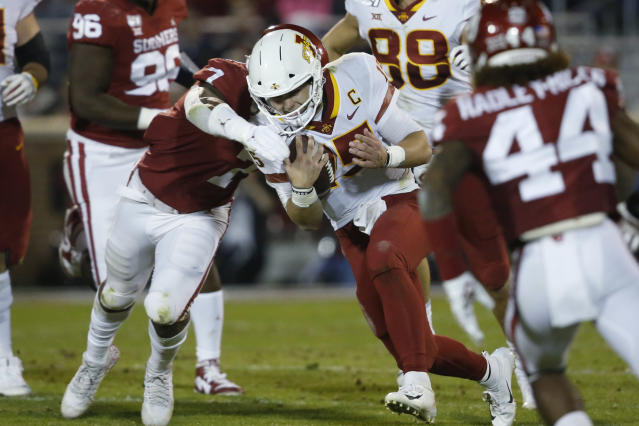 Iowa State quarterback Brock Purdy (15) is tackled by Oklahoma defensive lineman Ronnie Perkins (7) during the second quarter of an NCAA college football game in Norman, Okla., Saturday, Nov. 9, 2019. (AP Photo/Sue Ogrocki)