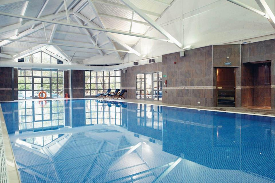 """<p><strong>Current deal: One-night spa break for two from £74.50</strong></p><p><strong>Spa breaks available from 1 August</strong></p><p>For a cheap spa break in the UK, <a href=""""https://go.redirectingat.com?id=127X1599956&url=https%3A%2F%2Fwww.spabreaks.com%2Fvenues%2Fmacdonald-frimley-hall&sref=https%3A%2F%2Fwww.womenshealthmag.com%2Fuk%2Ffitness%2Ffitness-holidays%2Fg31282174%2Fbest-spas-in-uk%2F"""" rel=""""nofollow noopener"""" target=""""_blank"""" data-ylk=""""slk:Macdonald Frimley Hall Hotel & Spa"""" class=""""link rapid-noclick-resp"""">Macdonald Frimley Hall Hotel & Spa</a> provides a great location close to Heathrow and Windsor Castle alongside fantastic spa offerings. </p><p>There's an indoor swimming pool, a sauna, steam room and five treatment rooms, plus Elemis treatments. Bringing you one of the best spa hotels in the UK, this attractive manor house is also where you can try an array of gym and fitness classes for an invigorating workout. </p><p> <a class=""""link rapid-noclick-resp"""" href=""""https://go.redirectingat.com?id=127X1599956&url=https%3A%2F%2Fwww.spabreaks.com%2Fvenues%2Fmacdonald-frimley-hall&sref=https%3A%2F%2Fwww.womenshealthmag.com%2Fuk%2Ffitness%2Ffitness-holidays%2Fg31282174%2Fbest-spas-in-uk%2F"""" rel=""""nofollow noopener"""" target=""""_blank"""" data-ylk=""""slk:FIND OUT MORE"""">FIND OUT MORE</a></p>"""
