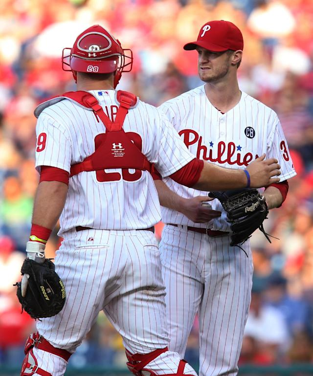 Philadelphia Phillies pitcher Kyle Kendrick confers with catcher Cameron Rupp after Kendrick gave up a three-run home run to Atlanta Braves' Freddie Freeman in the first inning of a baseball game, Friday, June 27, 2014, in Philadelphia. (AP Photo/Laurence Kesterson)