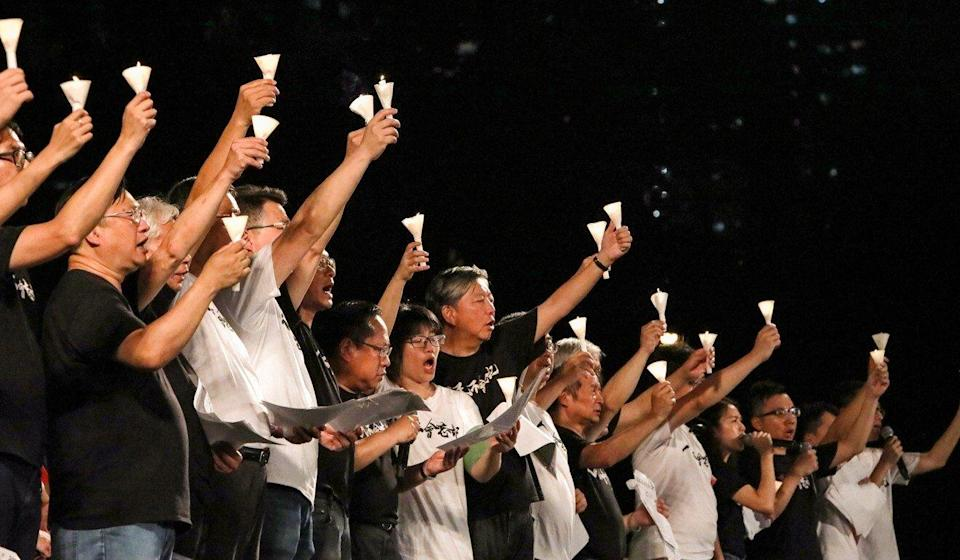 Members of the Hong Kong Alliance in Support of Patriotic Democratic Movements of China raise candles at a June 4 vigil in 2019. Photo: Felix Wong
