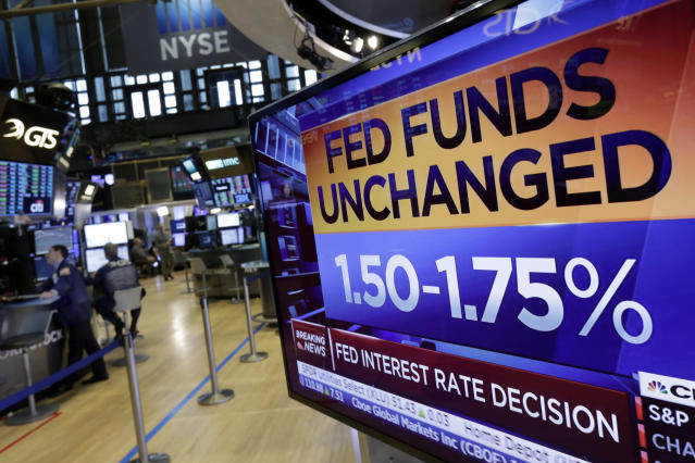 A screen on the floor of the New York Stock Exchange shows the rate decision of the Federal Reserve, Wednesday, May 2, 2018. The Federal Reserve is keeping its benchmark interest rate unchanged but says that inflation is climbing after years of being stuck below the Fed's target level. (AP Photo/Richard Drew)