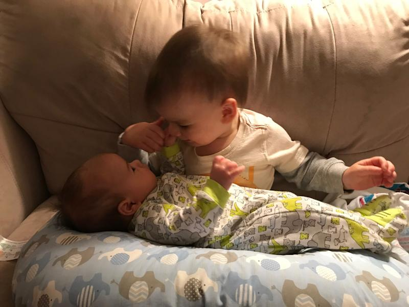 Reporter Victoria Freile's sons. Big brother Joe holds baby Luke for the first time.