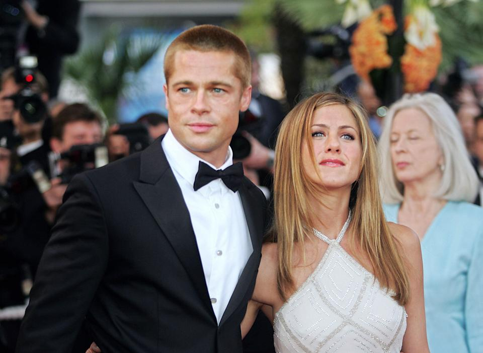 "Before the split: The couple arrive at the Cannes Film Festival for the official release of ""Troy"" on May 13, 2004. (Photo: BORIS HORVAT via Getty Images)"