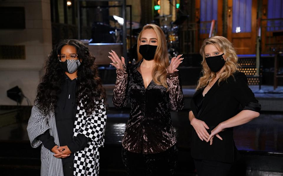 Adele wears an Acne shirt with musical guest H.E.R on SNL - Getty